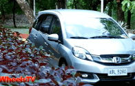 Coach Jim Saret drives Kap around in a Honda Mobilio